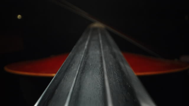 Slow motion artistic macro of master artisan luthier playing with a bow on a handmade violin or cello. Shot in 8K. Concept of spiritual instrument, art, orchestra, passion for music, sound, pre Slow motion artistic macro of master artisan luthier playing with a bow on a handmade violin or cello. Shot in 8K. Concept of spiritual instrument, art, orchestra, passion for music, sound, precision Slow motion artistic macro of master artisan luthier playing with a bow on a handmade violin or cello. Shot in 8K. Concept of spiritual instrument, art, orchestra, passion for music, sound, precision classical concert stock videos & royalty-free footage