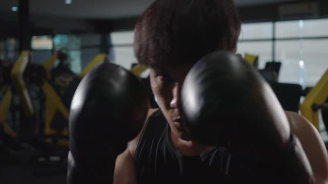4K Slow motion Asian Men Exercising in the gym, Boxing