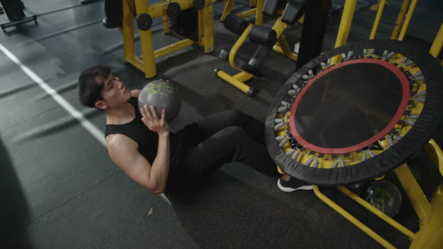 4K Slow motion Asian Men Exercising in the gym, Weightlifting Strong man doing barbell, in the Hardcore Gym. Muscular and Athletic Bodybuilder
