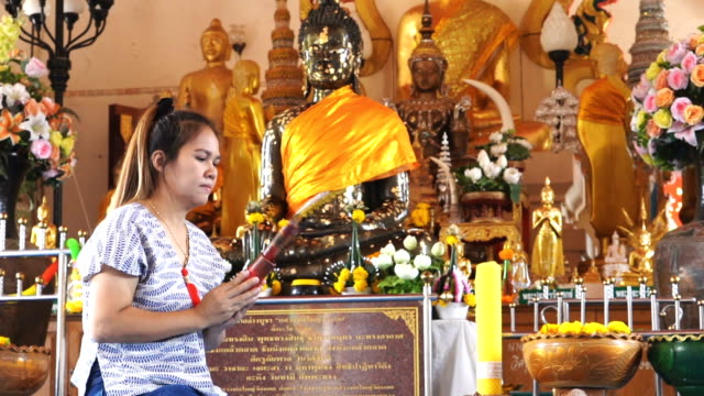 Slow Motion Asian women pay respect to monks and Horoscopes.