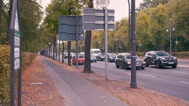 berlin, germany - october 02, 2018. slow motion autumn street in the center of the capital. cars drive past the camera - viale video stock e b–roll