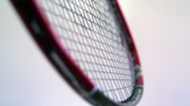 slow motion badminton racket hitting shuttlecock - badminton stock videos & royalty-free footage