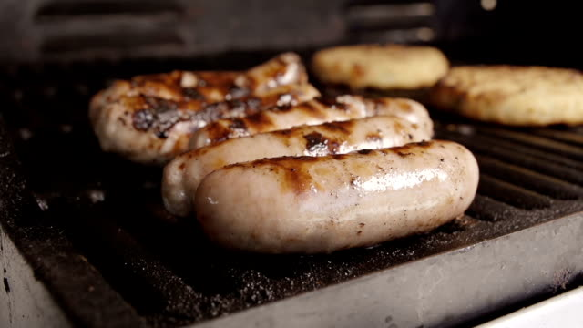 Slow Motion BBQ Sausages Burgers and Veggie Burgers video
