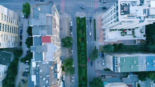 Slow motion bird's eye looking down shot of a drone flying over city