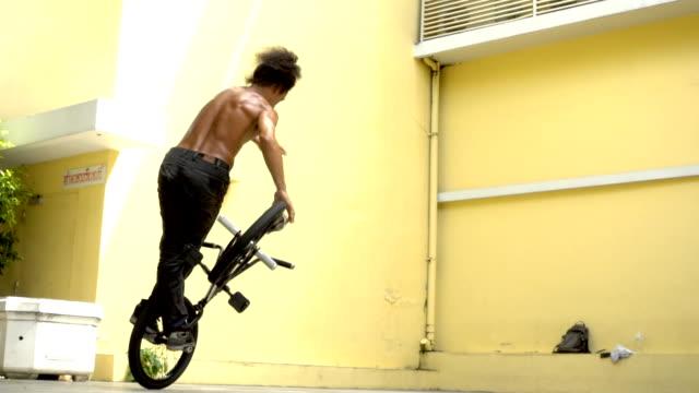 Slow Motion BMX Flatland spin trick , Asian Model. video