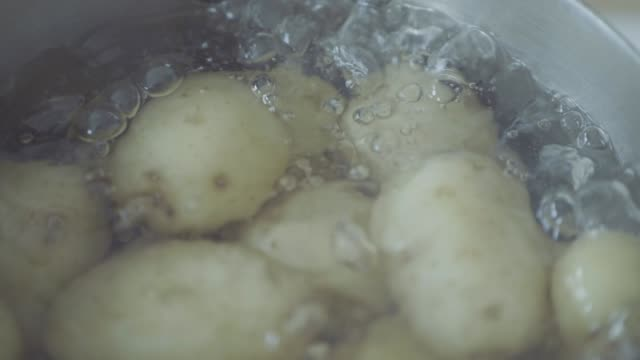 slow motion boiling baby potato in a  pot