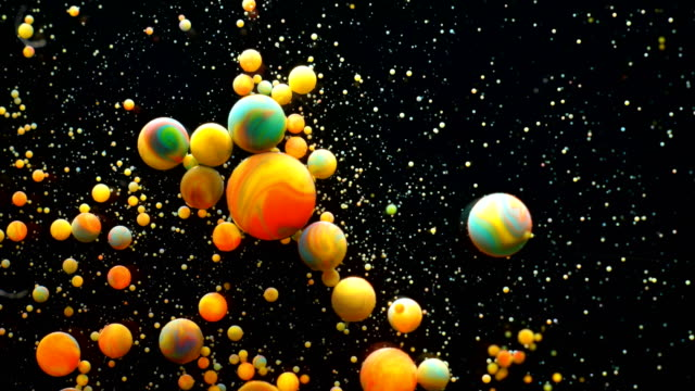 slow motion bright colors bubbles oil beautiful paint universe color moving multicolored close up. acrylic paint. fantastic hypnotic surface. abstract colorful paint metamorphosis structure bubbles - atomo video stock e b–roll