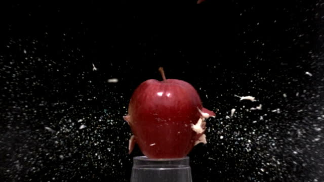 Slow motion bullet through an apple video