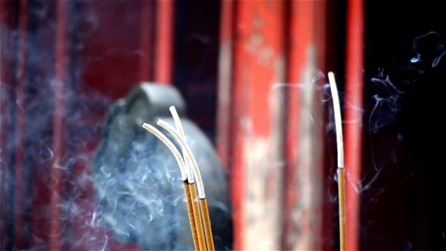 Slow motion - Burning Incense atNgoc Son Temple in Hanoi, Vietnam video