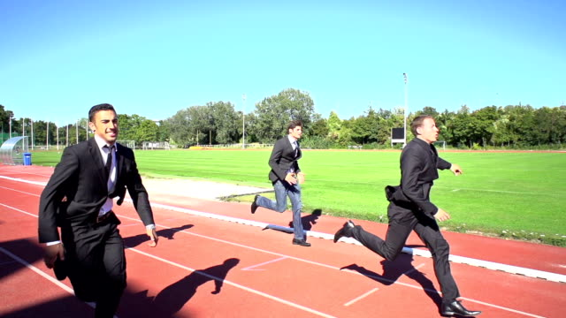 slow motion business men finishing run video