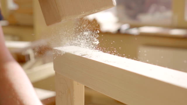 Slow motion: Carpenter using hammer video