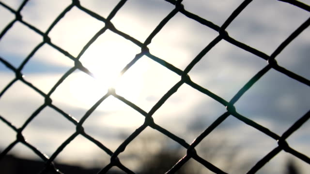 Slow motion: Chain Fence Against Golden Sun video