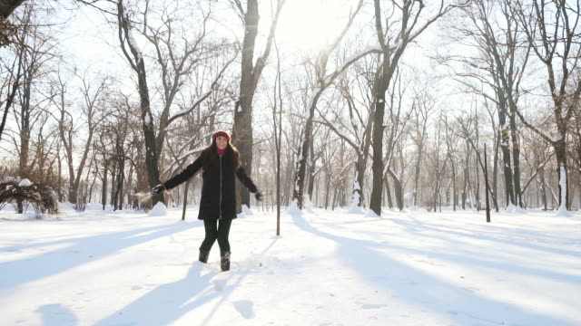 Slow motion: cheerful woman enjoying the snow. video