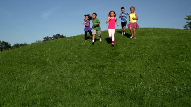 Slow Motion Children Running Down a Hill video