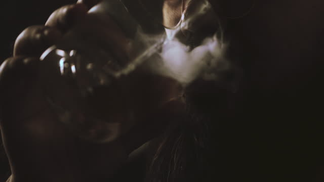stockvideo's en b-roll-footage met slow motion : sigaret en alcohol - guy with cigar