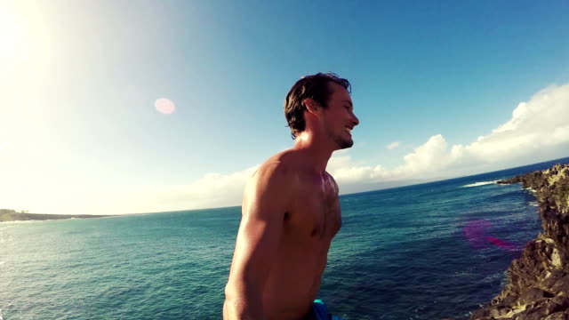 POV Slow Motion Cliff Jumping Backflip. Athletic Young Man Jumping From Cliff Into Ocean. video
