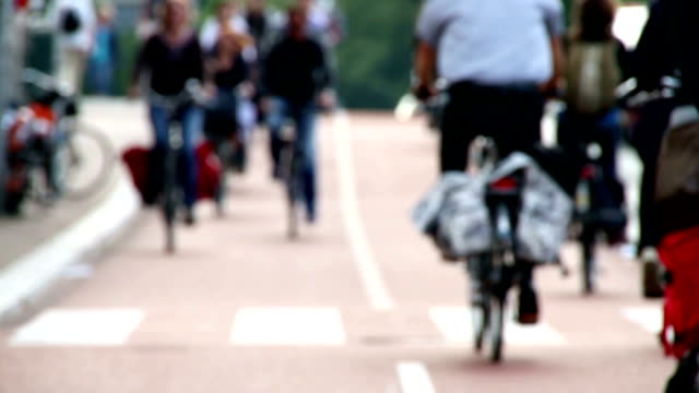 HD Slow Motion Clip Of Bicycle Commuters Slow Motion shot of Amsterdam commuters traveling around the centre city during rush-hour. cycle vehicle stock videos & royalty-free footage