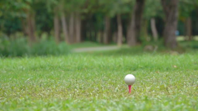 slow motion close up hitting t-off golf ball to green golf video