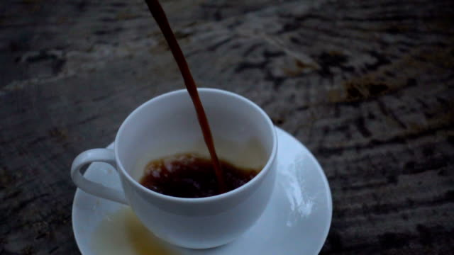 Slow motion close up of coffee pouring into a cup video