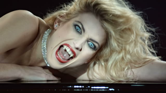 HD Slow Motion: Close-Up Of A Beautiful Vampire HD1080p: Slow Motion shot of a beautiful vampire woman waking up and snarling at camera. Recorded at 96 fps. vampire stock videos & royalty-free footage