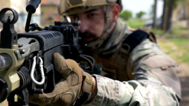 Slow motion closeup of soldier and his military gun during special training exercise video