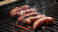 istock Slow motion close-up sausages being cooked on grill 1253623525