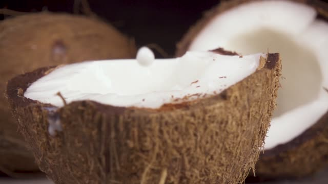 Slow motion coconut milk and coconut halves