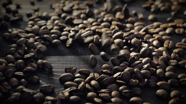 Slow motion: coffee beans falling down Slow motion: coffee beans falling down on a black wooden table. roasted stock videos & royalty-free footage