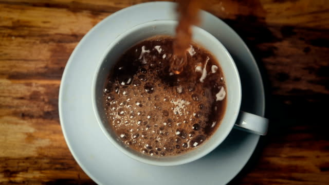 slow motion coffee pouring in cup - coffee стоковые видео и кадры b-roll