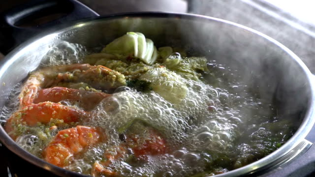 Slow motion: Cooking of spicy seafood soup hot pot video