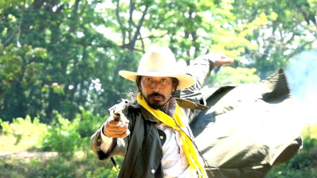 Slow Motion Cowboy Drawing Gun Pointing At Camera