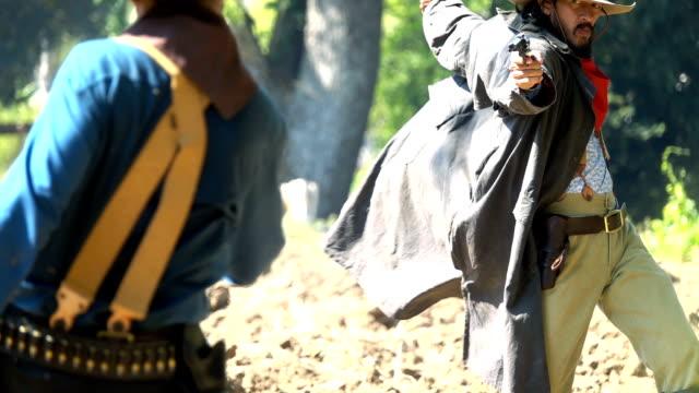 Slow Motion Cowboys Drawing Gun Shooting At Enemy