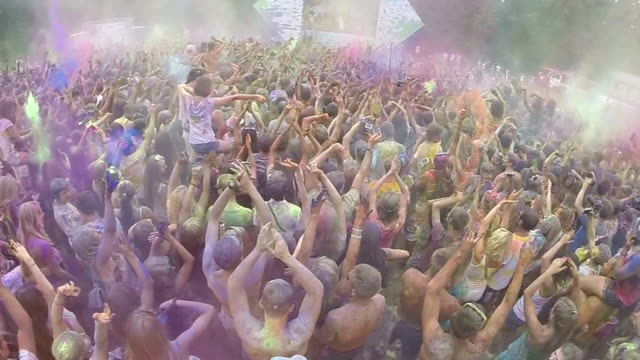 Slow motion crowd of young people enjoying music festival video