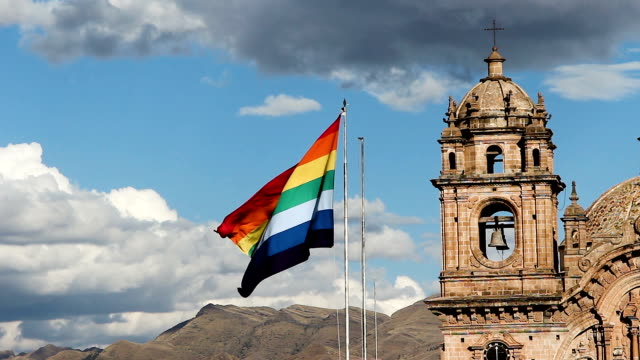 Slow Motion Cusco Peru Flag Flying With Bell Tower In Background video