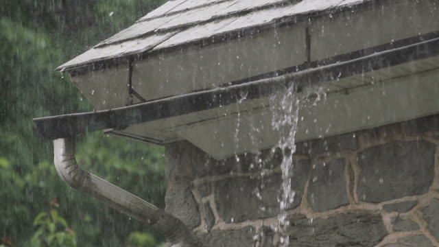 Slow motion downpour as gutter overflows video