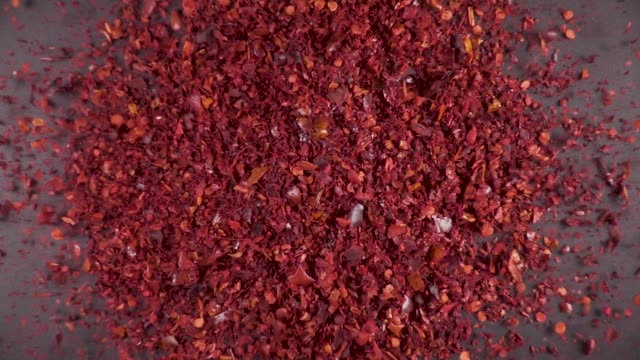 Slow motion dry spices fall down Slow motion ground chili pepper dry spice powder falling on gray background from under the camera spice stock videos & royalty-free footage