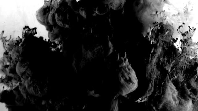 vídeos de stock e filmes b-roll de slow motion exploding tubers of grey smoke on white background - exhaust white background