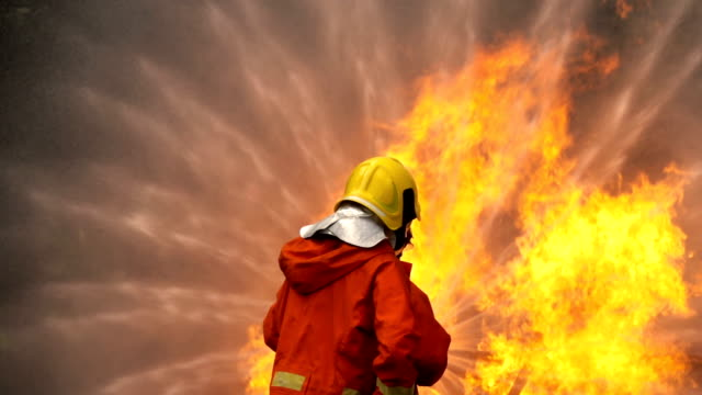 Slow Motion Fire Fighter Using Fire Hose To Extinguish A Fire Of Car Accident, Traffic Accident Super Slow Motion Of Fire Fighter Using Fire Hose To Extinguish A Fire Of Car Accident, Traffic Accident rescue worker stock videos & royalty-free footage