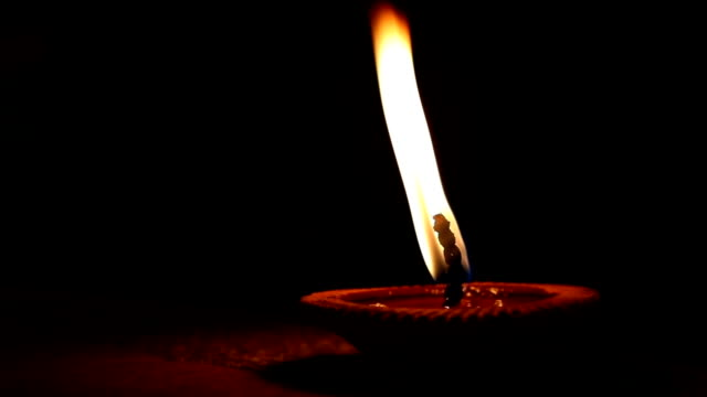slow motion fire flame, candle light pray faith peace of religion spirituality video