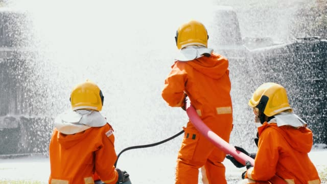 Slow Motion : Firefighters fighting a fire with foam spray Slow Motion : Firefighters fighting a fire with foam spray by high pressure nozzle to truck fire after the accident, Bangkok Thailand rescue worker stock videos & royalty-free footage