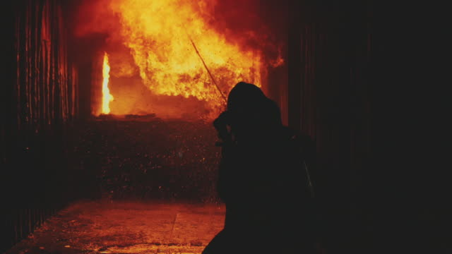 slow motion : firefighters/fireman. - tubo flessibile video stock e b–roll