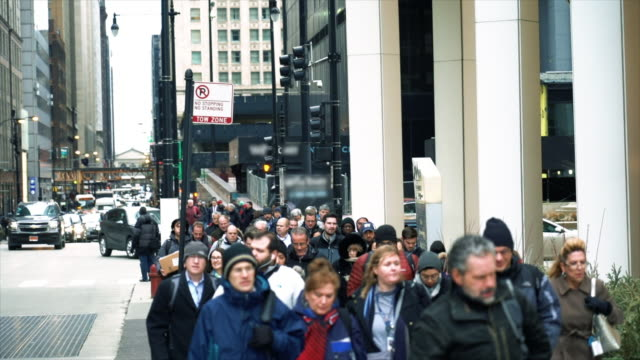 4K Slow motion footage crowd of Pedestrians walking on the street in rush hour among modern buildings in Chicago, Illinois, United States, Business and American culture concept