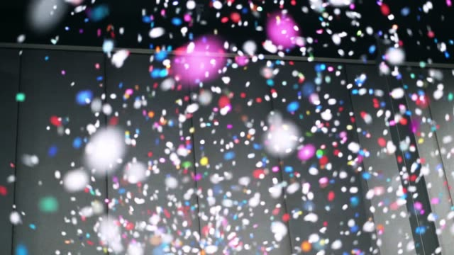 4K Slow motion footage of colorful confetti falling from above in the room, Celebrating with happy new year and Party concept Footage of colorful confetti falling from above in the room, Celebrating with happy new year and Party concept, 4K Slow motion  clip carnival celebration event stock videos & royalty-free footage