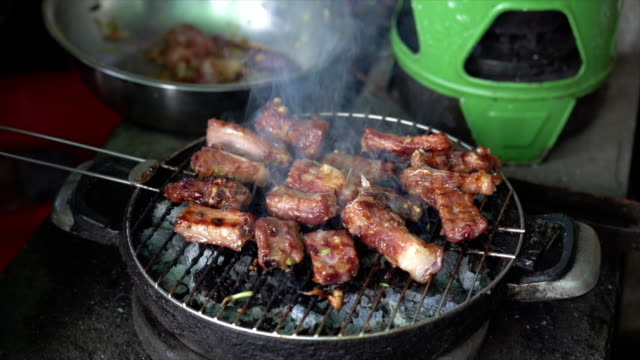 4K Slow motion footage of grilling Pork on charcoal grill, Cooking food and barbecue concept