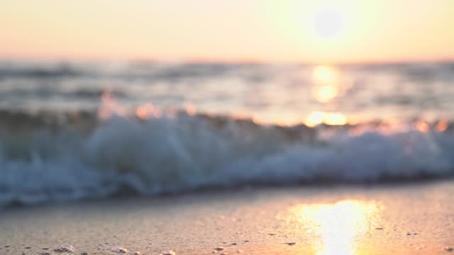 Slow motion footage of sea in sunset.