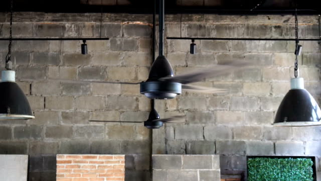 FHD slow motion footage of traditional Ceiling Fan Slowly Spins
