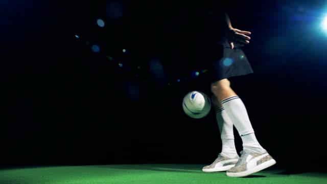 vídeos de stock e filmes b-roll de slow motion football run into field, making trick and run away. - liga desportiva