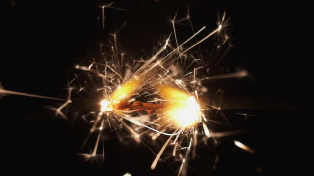 Slow motion. Gas lighter ignites sparkler. Bengal fire burning from center to edges. Slow motion. Gas lighter ignites sparkler. Bengal fire burning from center to edges. Black background pyrotechnic effects stock videos & royalty-free footage