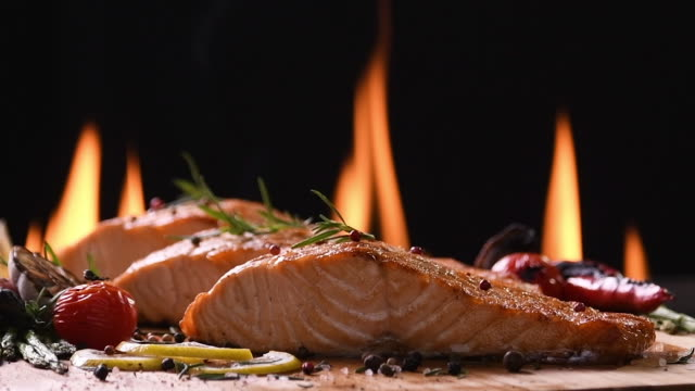 Slow motion : Grilled salmon on wooden table Slow motion : Grilled salmon on wooden table fillet stock videos & royalty-free footage