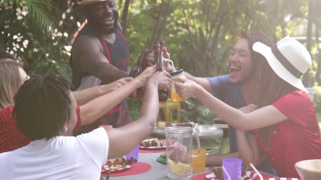 Slow motion group of people cheers on summer